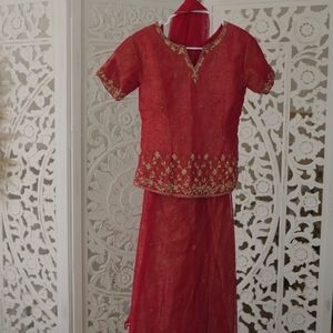 Red Indian outfit (lehenga) with gold bead work.